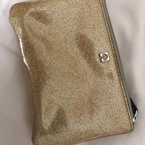 Kate Spade wristlet missing strap. Good condition